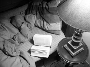 Reading in bed (c) me