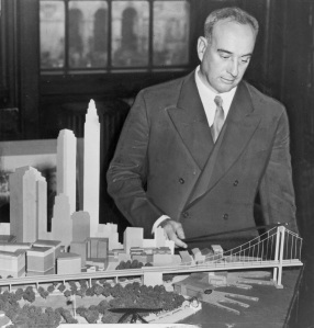 Robert Moses with a model of Battery Bridge, never built